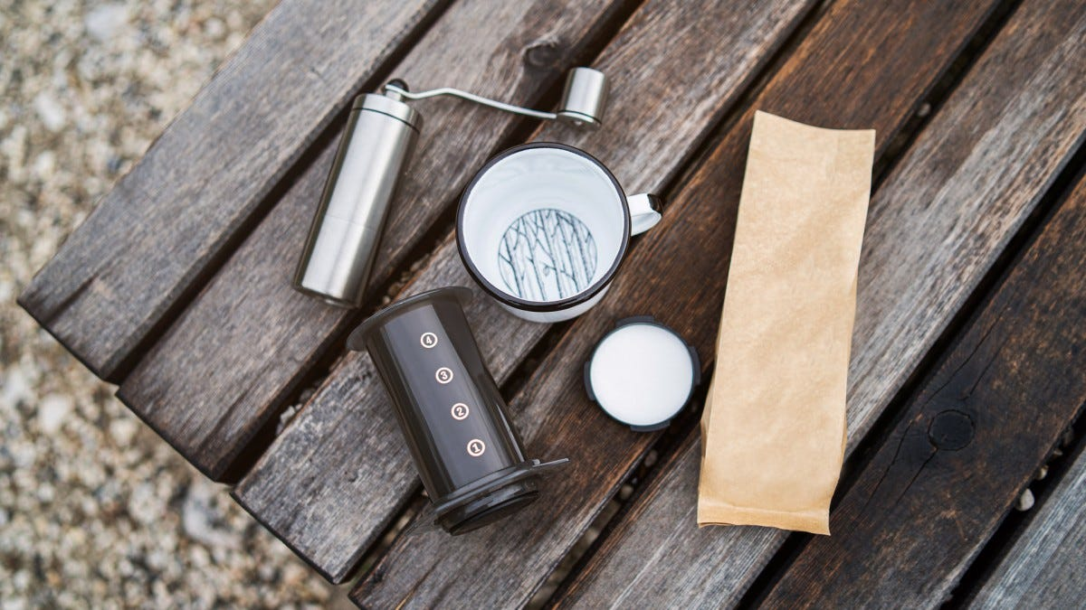 Travel coffee supplies in a bench