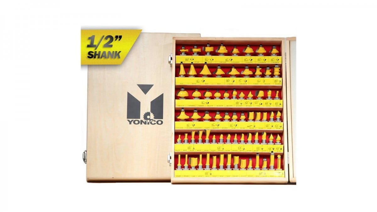 A wooden box holding 70 yellow router bits.