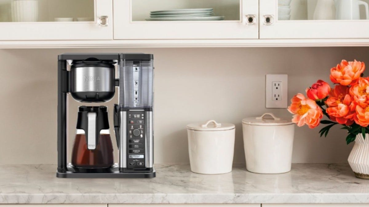 A Ninja Coffee bar system on a granite kitchen counter.