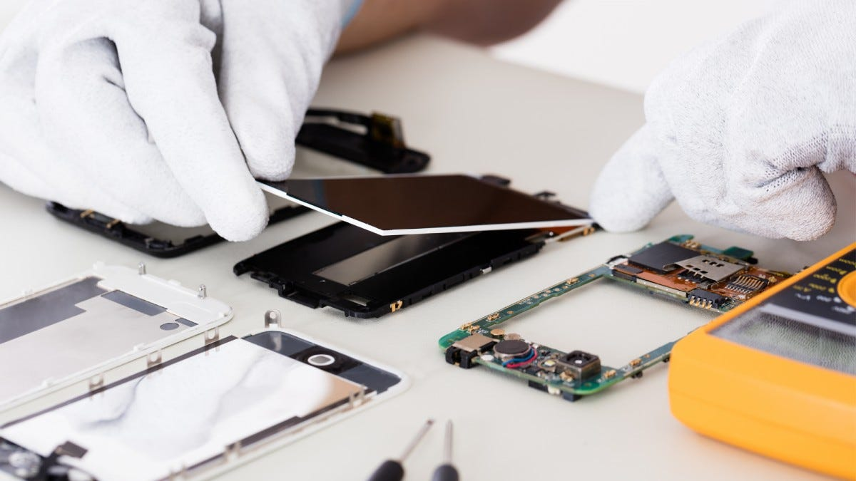 A technician repairing a smartphone screen.