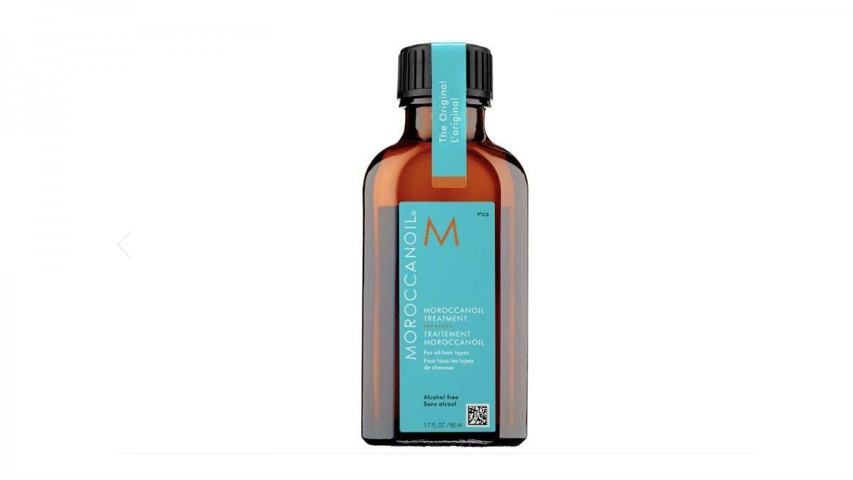 A bottle of Moroccanoil Treatment.