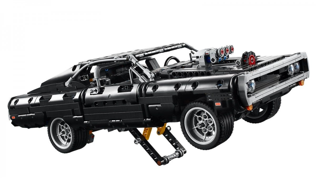 A LEGO Dodge charger with a stand stand down to prop it on the two back wheels.