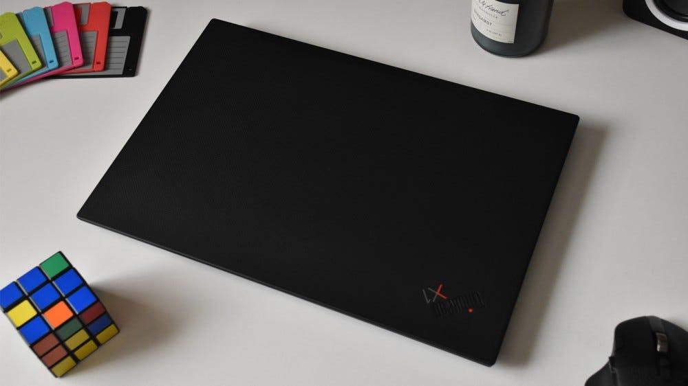 Lenovo ThinkPad X1 Extreme Gen 3 closed and sitting on white desk
