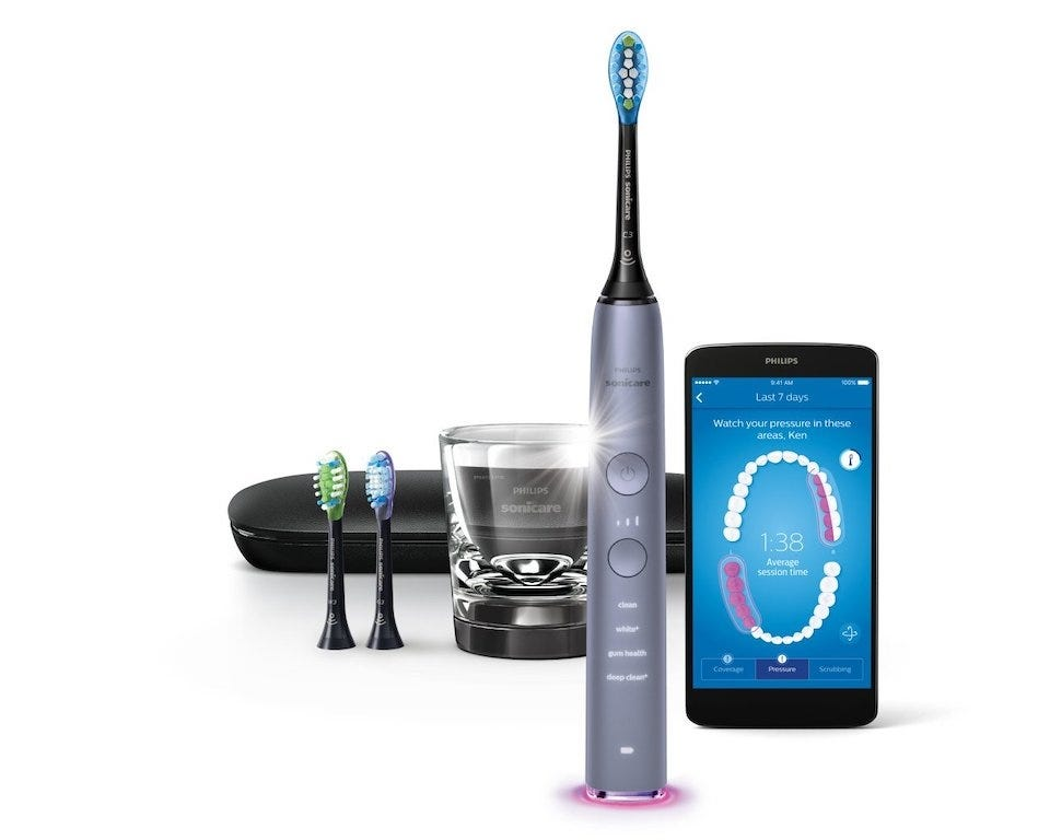 Philips Sonicare Diamond toothbrush with travel case and app displayed