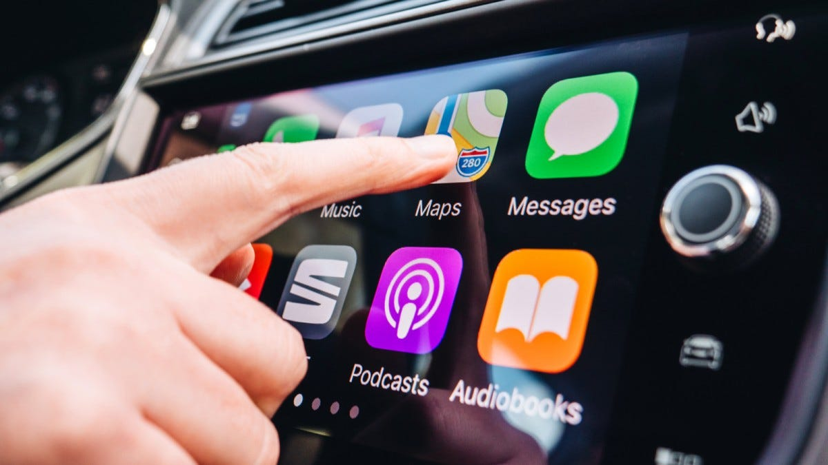 A person pressing a button on Apple Carplay