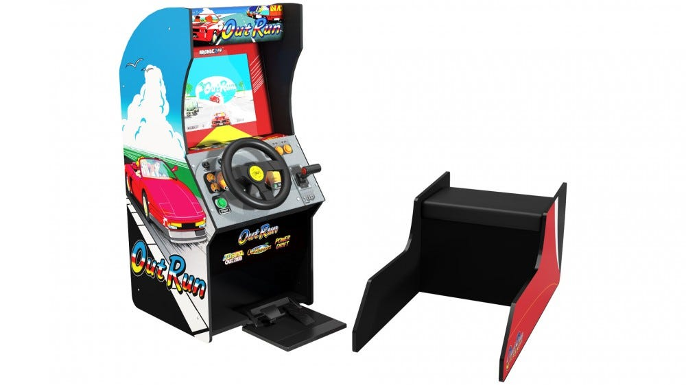 An Out Run arcade machine with a separated bench.