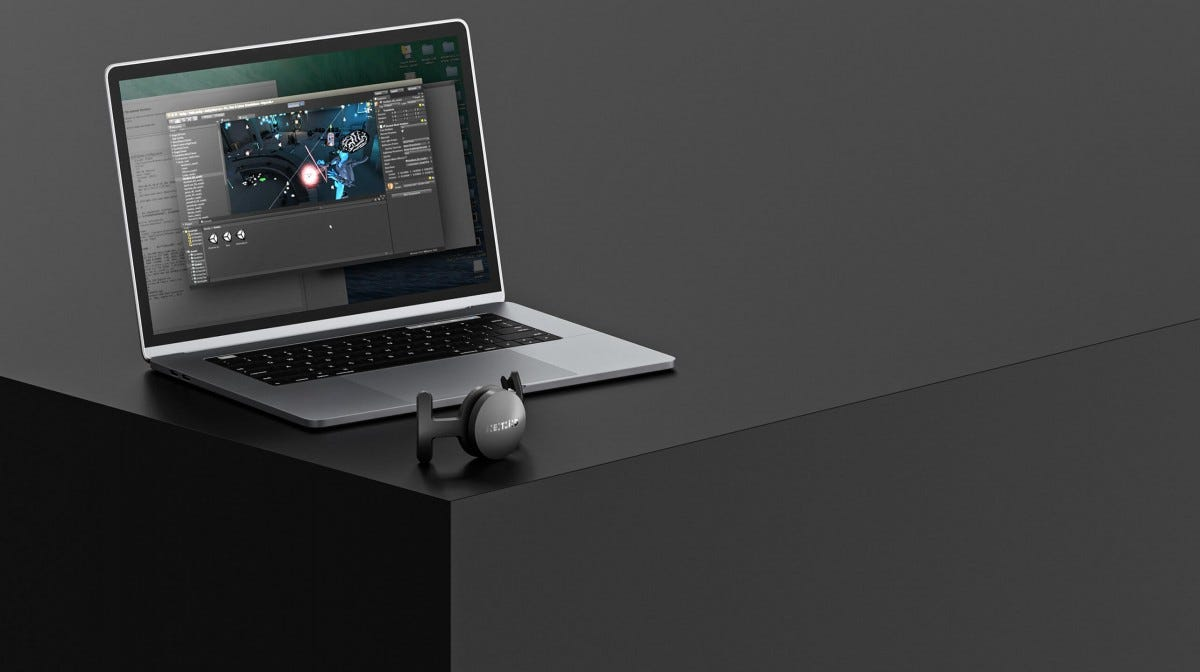 NextMind development kit next to a laptop.