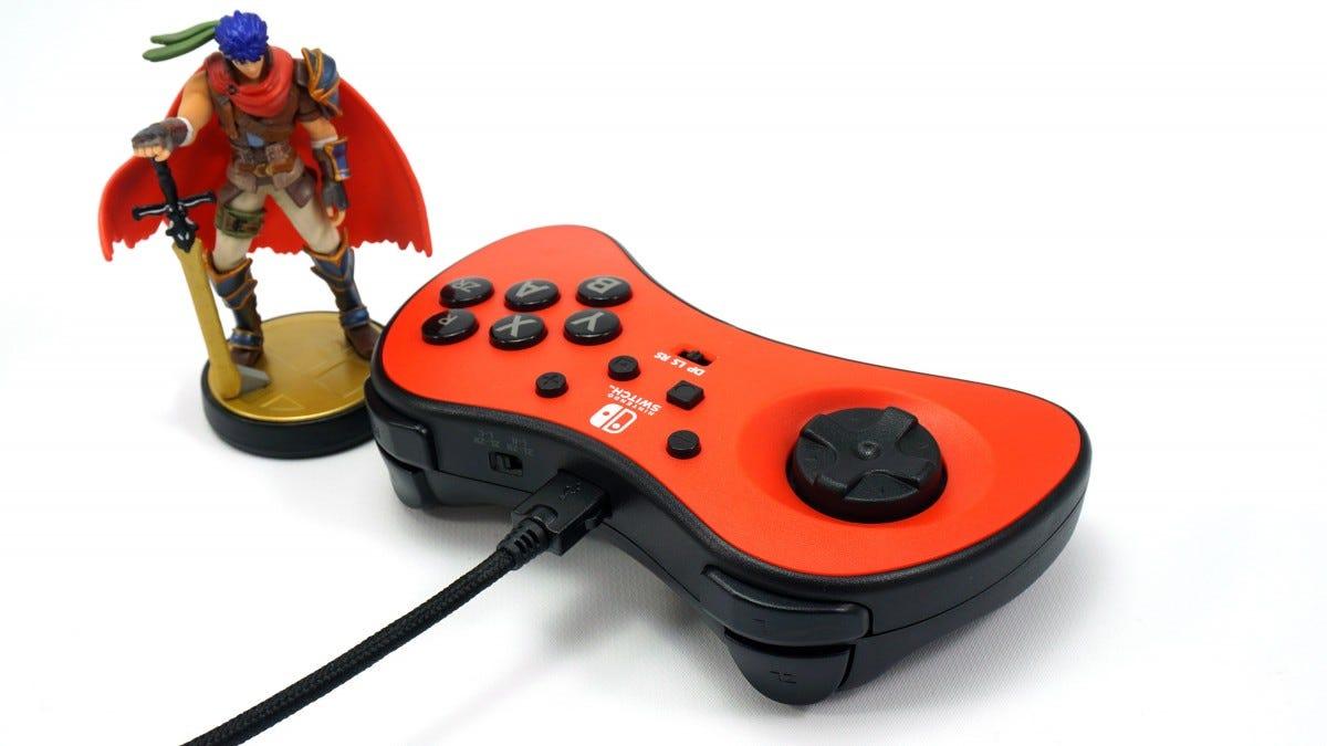 The PowerA Fusion FightPad, with an Amiibo