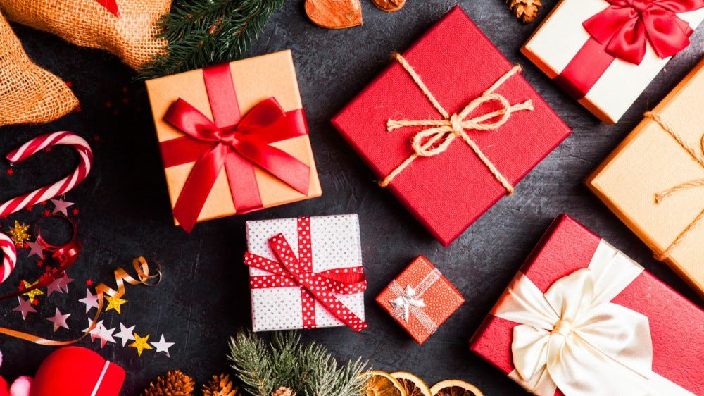 Holiday presents and decor against dark background