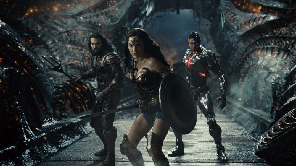 Aquaman, Wonder Woman, and Cyborg getting ready to battle.