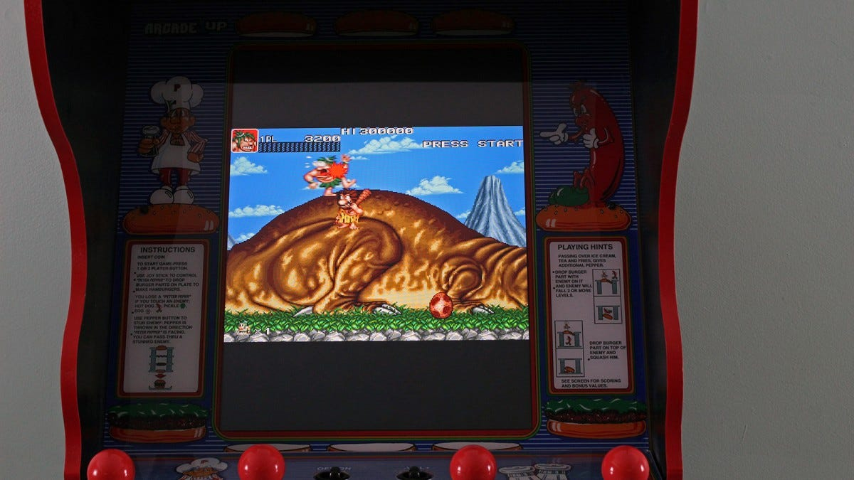 Caveman Ninja with a giant dinosaur on the screen, and black bars above and below the game.