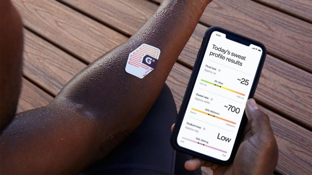 The Gx Sweat Patch on a man's arm while the app is open looking at the results