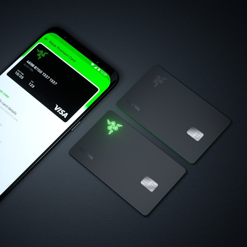 The Razer Pay app, glowing Razer card, and boring black Razer Card