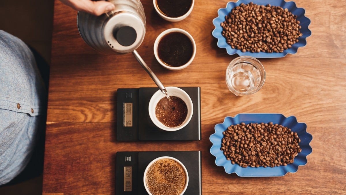 Artistically arranged coffee with beans and pourover