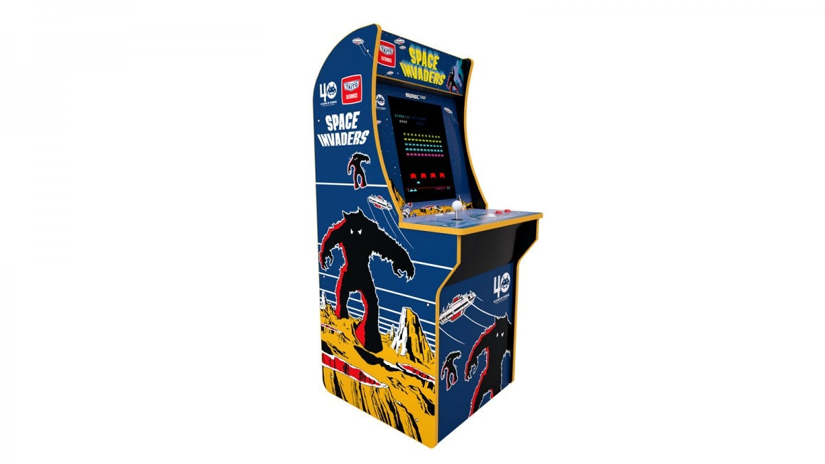 The Space Invaders arcade machine with red, blue, and green aliens.