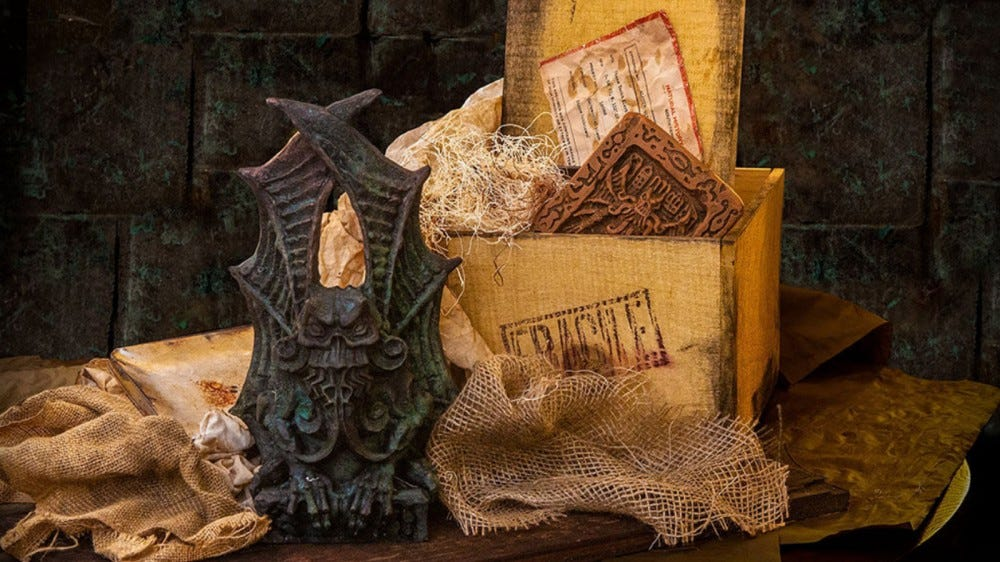 The Crate of Cthulhu box with documents, statues, and other items