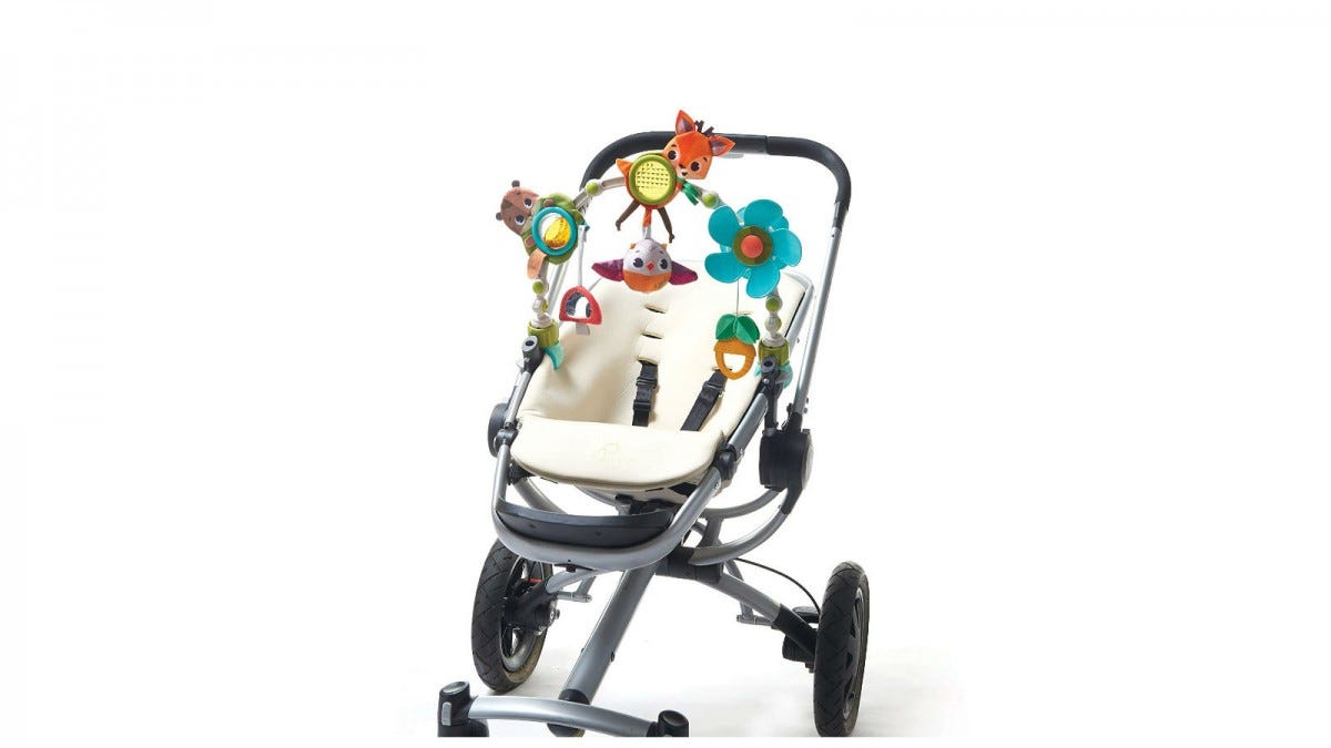 The Tiny Love Musical Nature Stroller Toy clipped to a stroller.