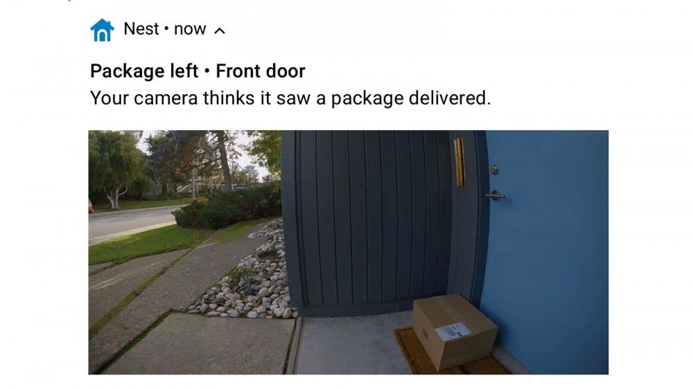 A Nest notification about a package at the door.