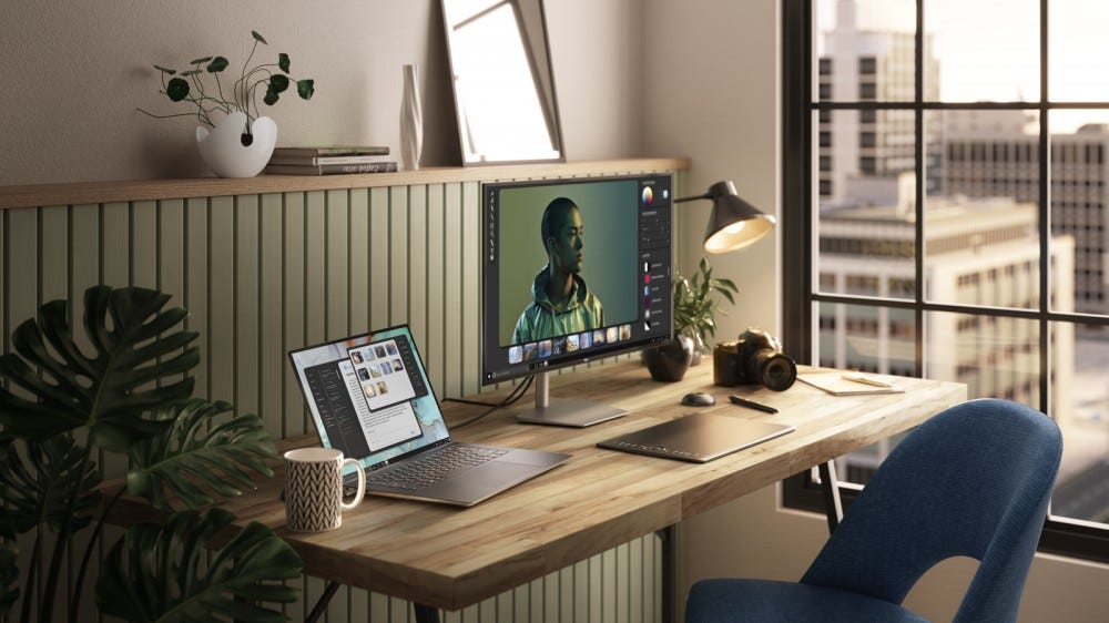 A Dell XPS 15 connected to a monitor.