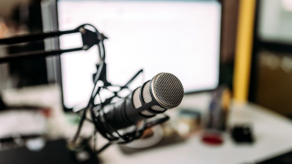 Microphone resting in front of computer