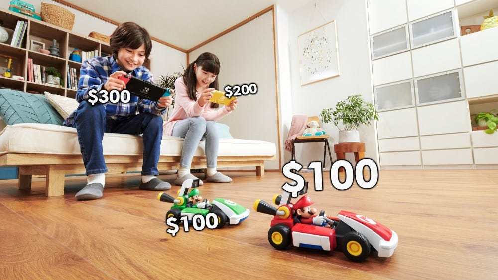 Kids playing with the 'Mario Kart Live: Home Circuit' RC cars.