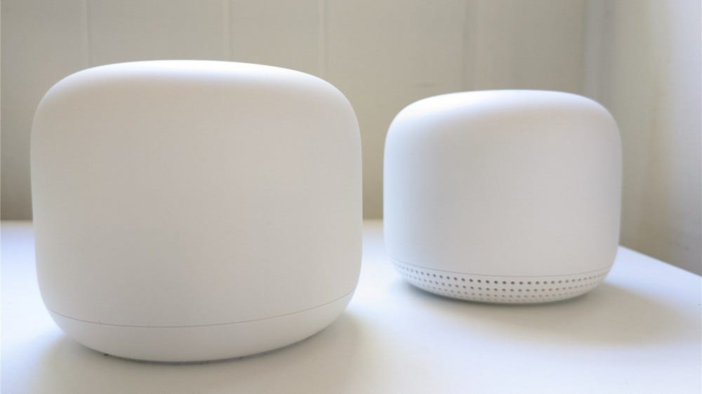 Nest Wifi router and point on a desk