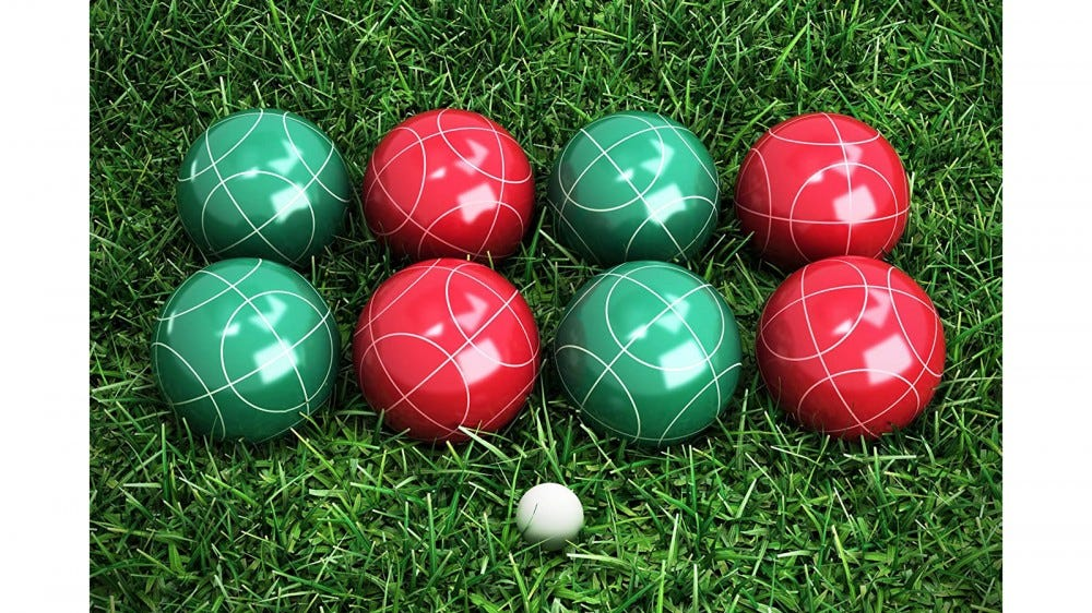 set of bocce balls and market ball on grass