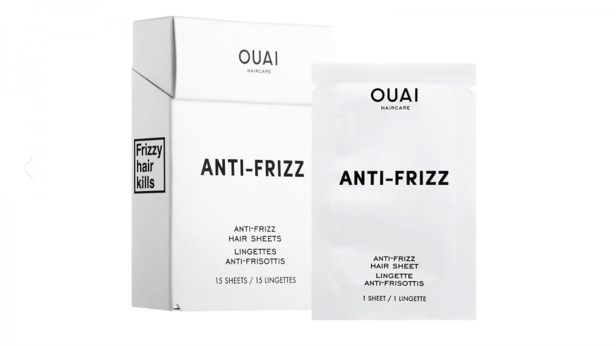 A box of 15 Ouai Anti-Frizz Hair Sheets next to a packet containing one sheet.