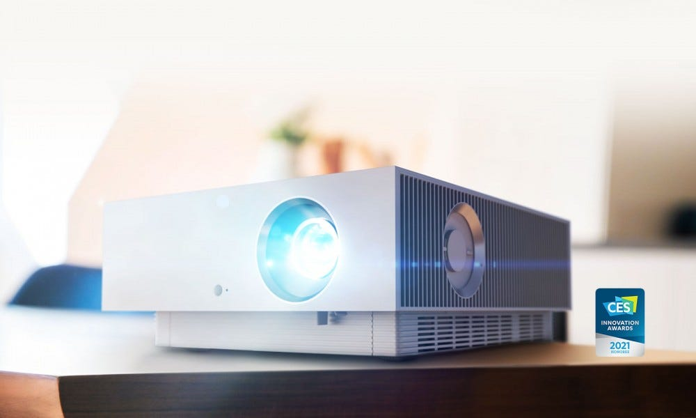 A 4K projector on a desk.
