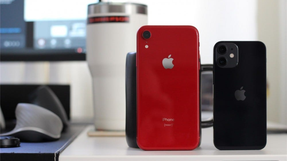 The red iPhone XR next to the black iPhone 12 Mini for size comparison.