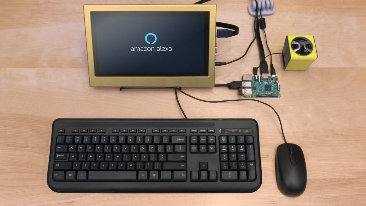 A keyboard, mouse, and monitor with Amazon Alexa on the screen connected to a Raspberry Pi.