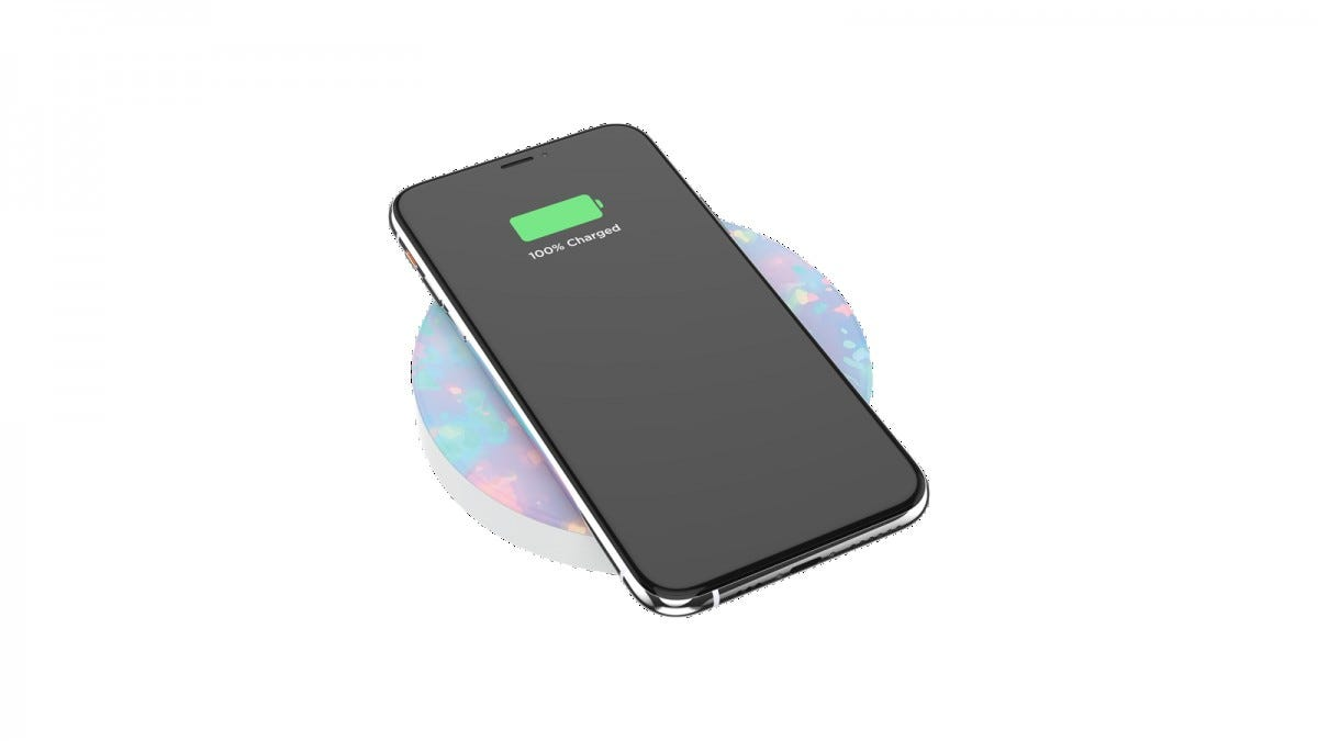 A PopSocket wireless charger with an iPhone on it, charging.