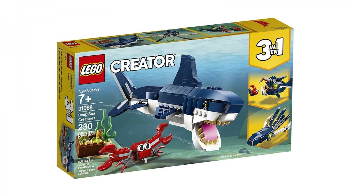 A LEGO 3-in-1 box featuring a shark, angler fish, and squid.