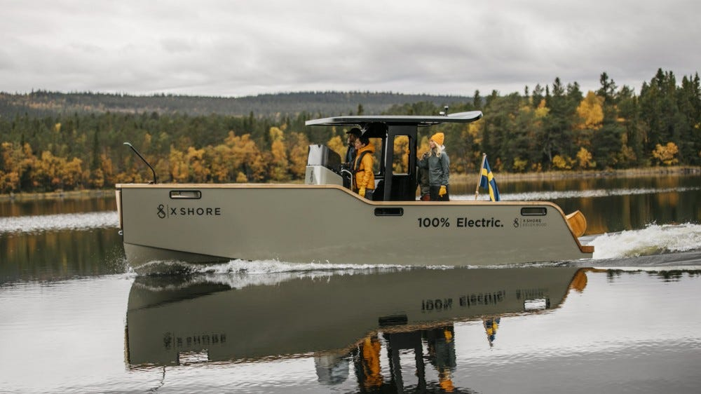 Full side view of an electric boat.