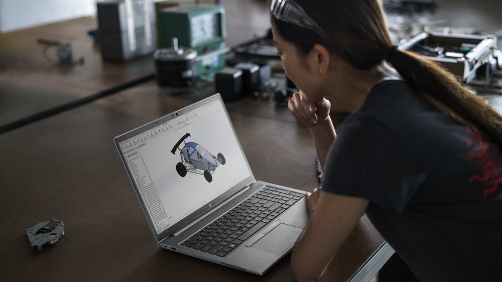 A woman staring at a car diagram on an HP ZBook Firefly laptop.