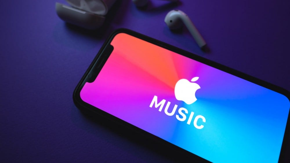 Apple Music logo on the smartphone screen, with airpods
