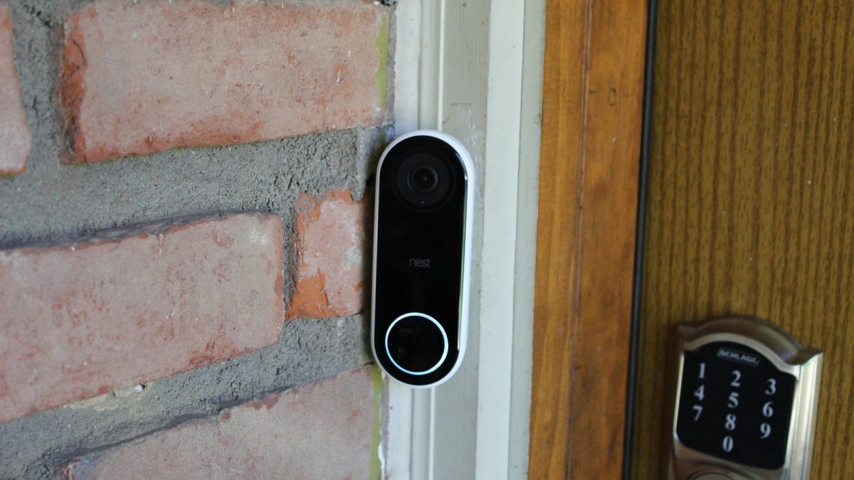 A Nest Hello Video doorbell, next to a smart lock.