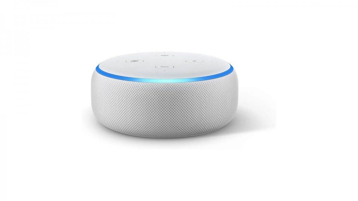 A white Amazon Echo with blue ring.