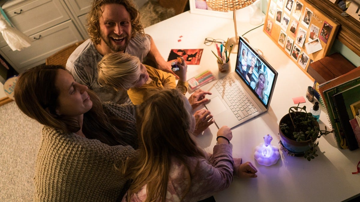 A family uses Teams to video chat with others.