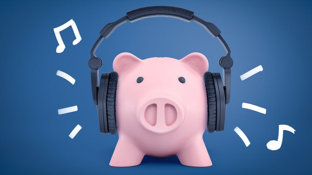 A plastic pig wearing headphones. no, seriously.