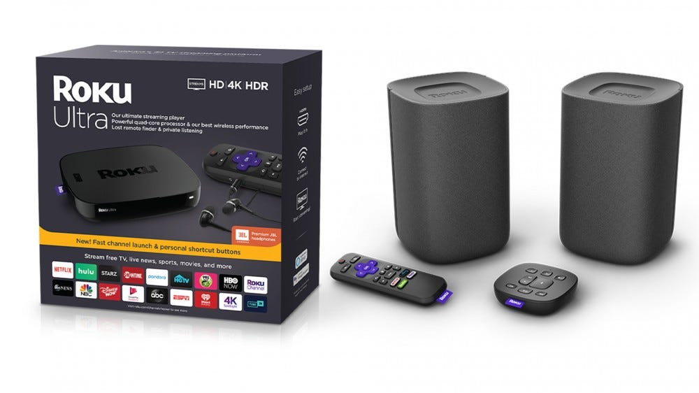 A photo of the Roku Ultra 4K streaming stick and Roku wireless speakers.