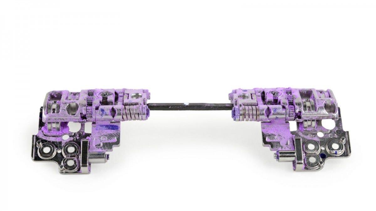 The Z Flip hinge, covered in purple powder.