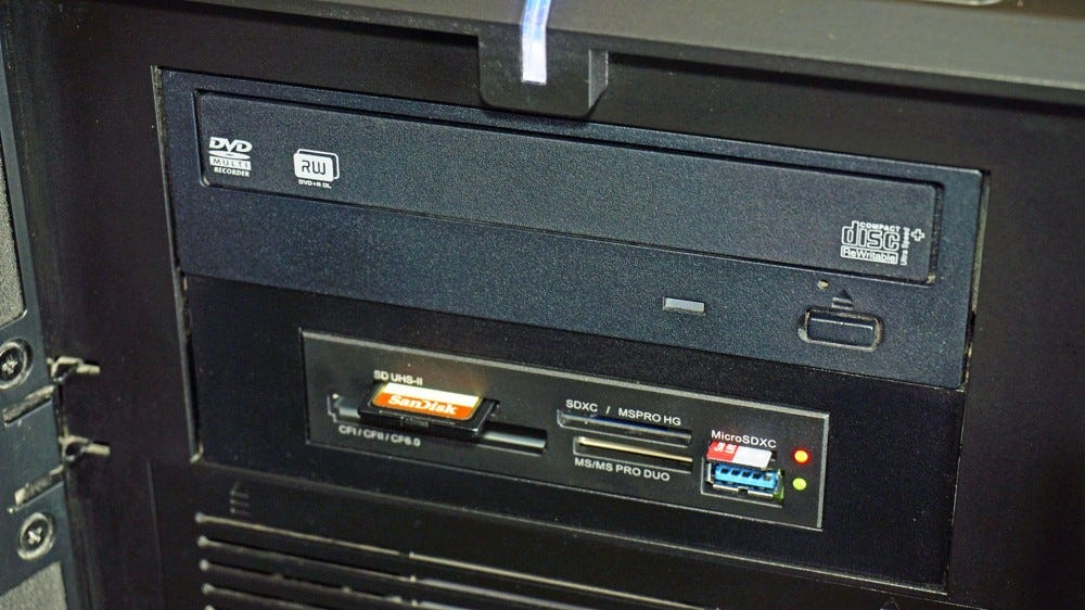 Two 5.25-inch drive bays: one a standard DVD drive, the other a 3.5-inch card reader in an adapter.