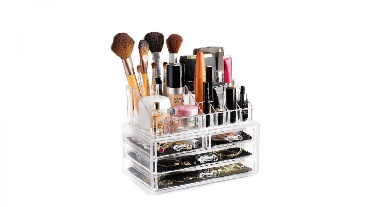 The Masirs Clear Cosmetic Organizer loaded with everything from brushes and makeup, to jewelry and perfume.