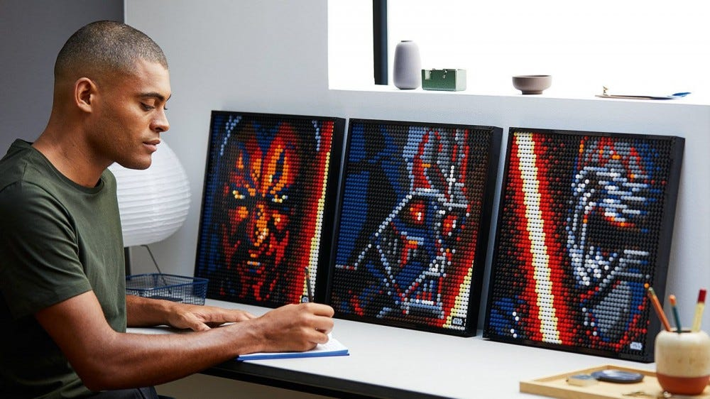 Darth Maul, Darth Vader, and Kylo Ren in LEGO art form.
