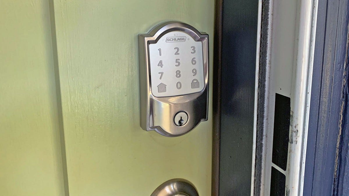 The Schlage Encode Wi-Fi lock installed on a green door.