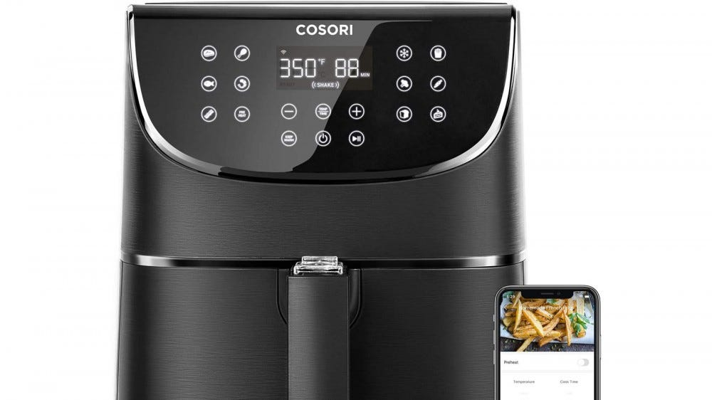 COSORI Smart Air Fryer next to smartphone with accompanying app for airfryer