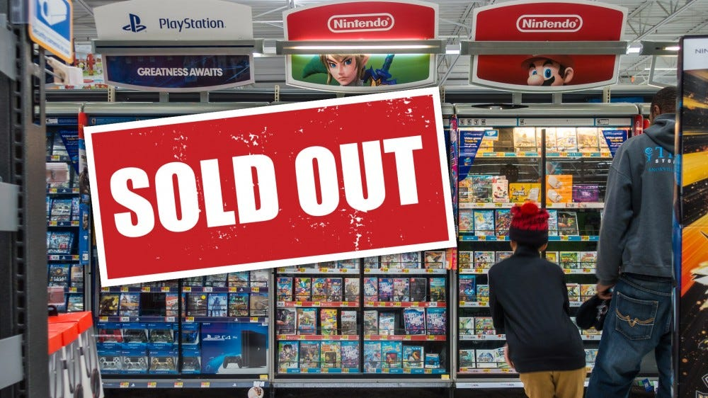 "Walmart game console shelf with ""sold out"" sign"