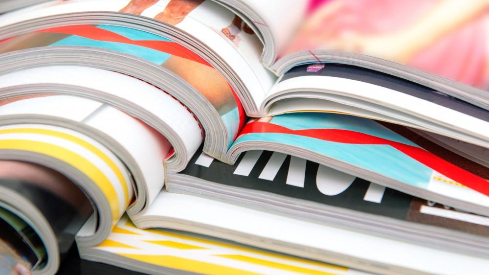 A stack of colorful magazines opened on top of each other