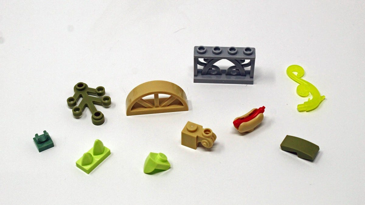 A lego hot dog, and several architecture pieces in varying colors.